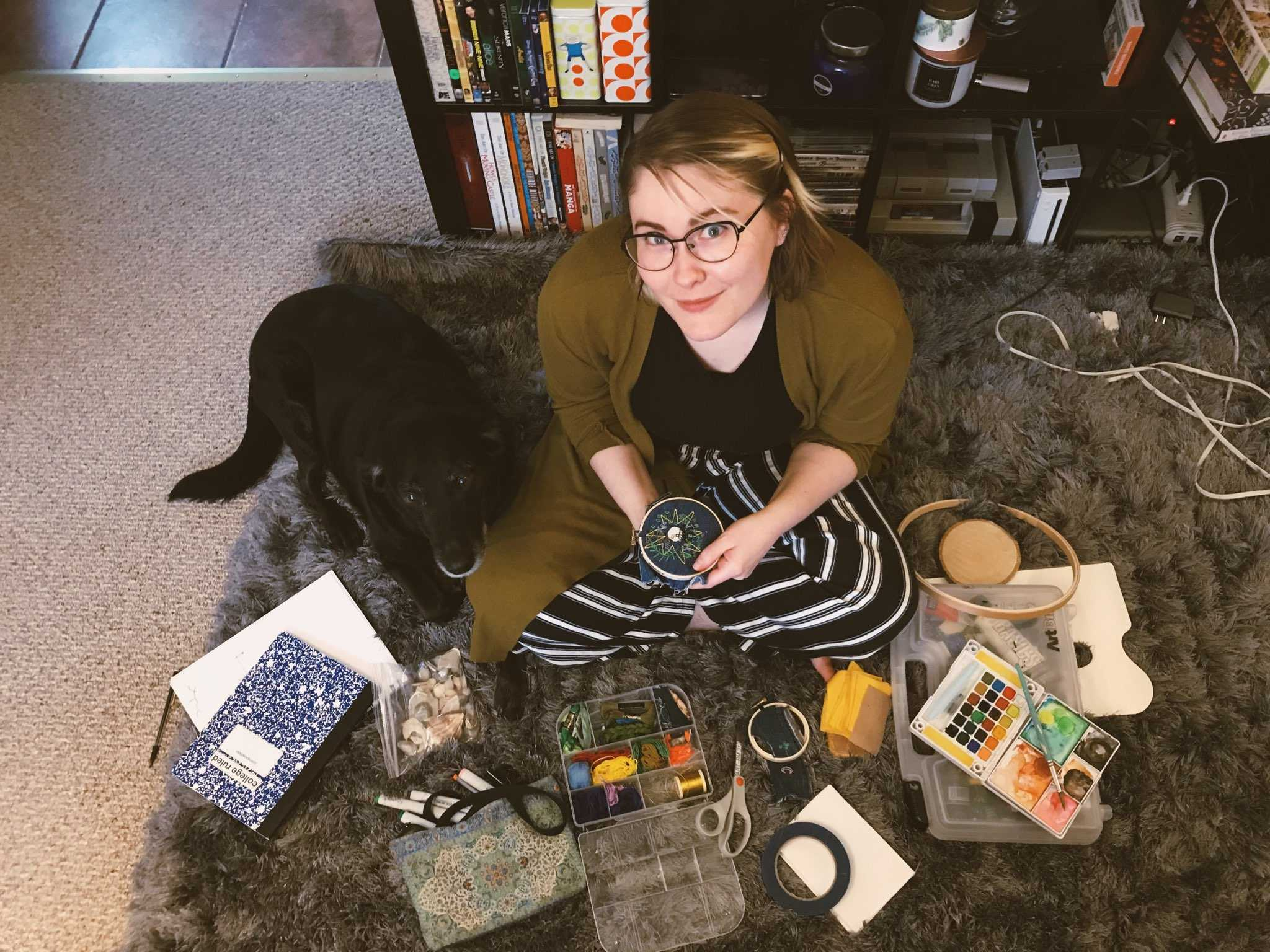 Robyn Webb surrounded by supplies