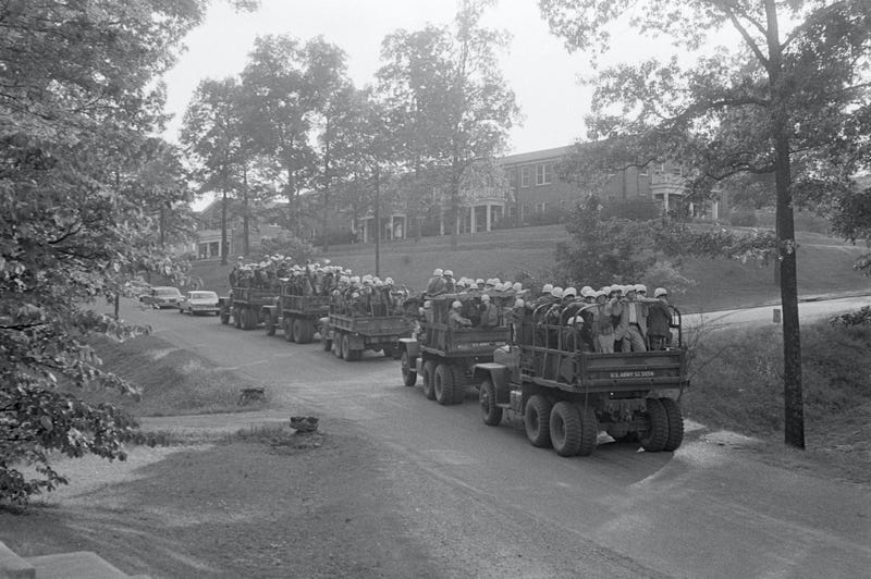 Text Box: Black students are provided with a military escort when entering and leaving Little Rock Central High School, Arkansas, following the school's desegregation in 1957.